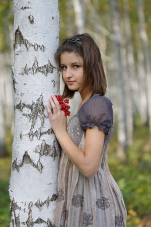 Portrait of the young girl near the birch photo