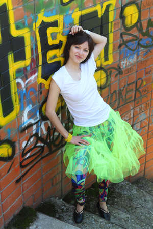 Young attractive girl brunette near the wall with graffiti Stock Photo - 6856799