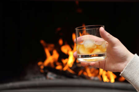 Whiskey by the fireplace Stock Photo - 7116104