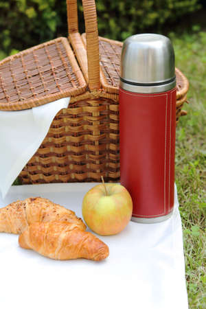 Outdoor picnic setting with hot flask photo