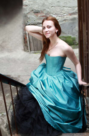 Romantic girl in the beautiful dress on the stairs photo