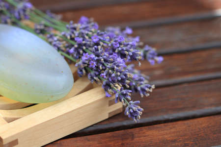 Bar of natural soap with lavender flowers photo