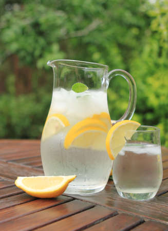 Pitcher and one glass of fresh lemonade Stock Photo - 7280394