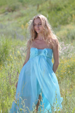 Romantic girl in the beautiful dress on the summer meadow Stock Photo - 7337179
