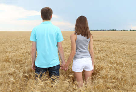 Young couple in the wheat field photo