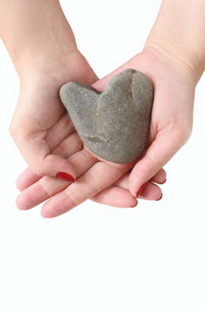 Heart from the stone in hands of the woman photo