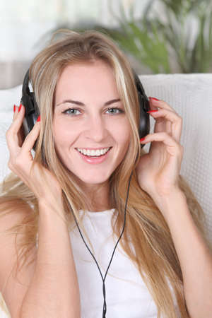 Portrait of the blond beauty smilling girl wearing headphones Stock Photo - 7564406