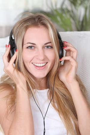 Portrait of the blond beauty smilling girl wearing headphones Stock Photo - 7564406