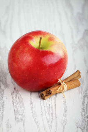 One red apple white the cinnamon Stock Photo - 7756356