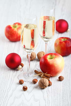 Apple cider with cinnamon, nuts and balls photo