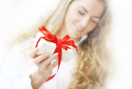 The blond girl with the present Stock Photo - 7854800