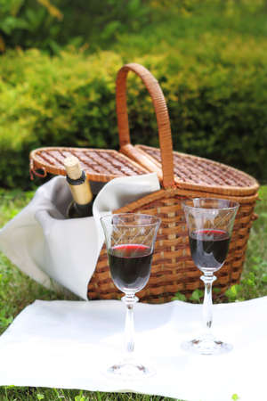 Outdoor picnic setting with wine. Summer photo