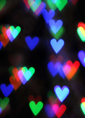 Blurred valentine background with heart shaped lights photo