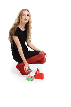 Attractive blonde young woman with presents in evening dress Stock Photo - 8012791