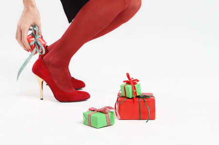 Girl in the red shoes gets her christmas present Stock Photo - 8079257