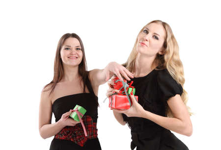 Two young girls with presents in evening dress Stock Photo - 8079256