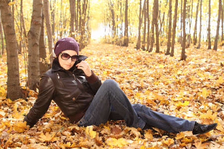 Young attractive woman in sun glasses in park in a sunny day photo