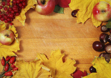 rusted background: Still life with aunumn leaves over wooden background Stock Photo