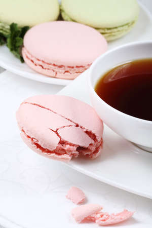 Cup of coffee and macaroon on a white background Stock Photo - 8079266