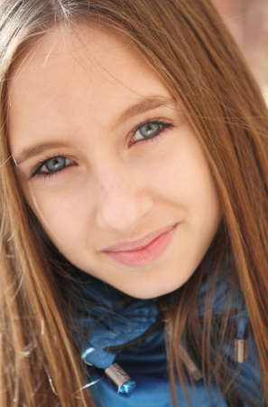 light brown eyes: Young teenager girl in the autumn forest
