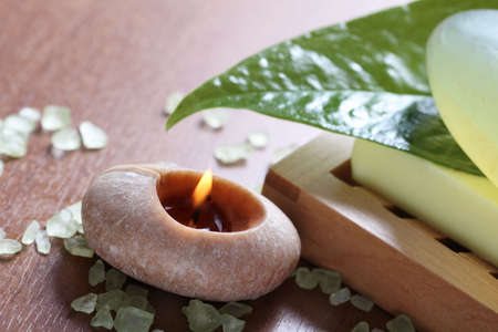 Spa setting with burning candle, soap and salt photo