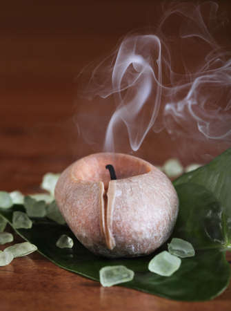 Spa setting with smoking candle and salt photo