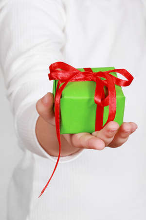 Little hand of the child holding a present Stock Photo - 8155007