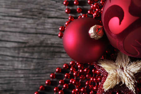 Red decoration on the wooden background. Close up Stock Photo - 8212812