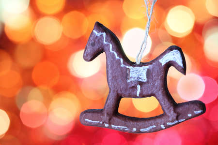 Gingerbread cookies horse decoration against blurred background photo