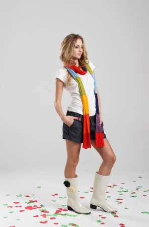 Beautiful girl wearing scarf and rubber boots in the studio photo
