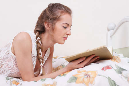 hairdress: Attractive blond girl with hairdress reading the book Stock Photo