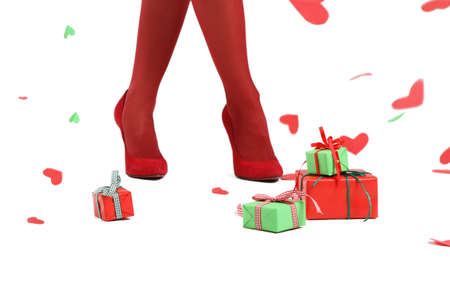 Presents and falling hearts for woman in red Stock Photo - 8394228