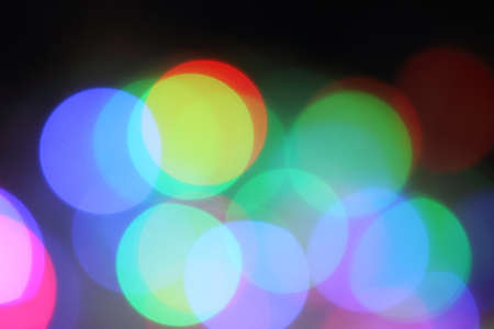 bright decoration color: Blurred background with round shaped lights on black