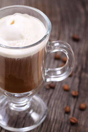 frappe: Ice cream coffee and coffee beans on the wooden background Stock Photo