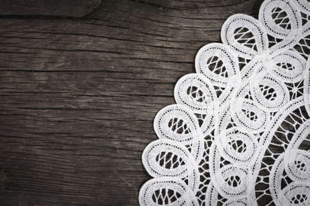 White lace on the wooden background