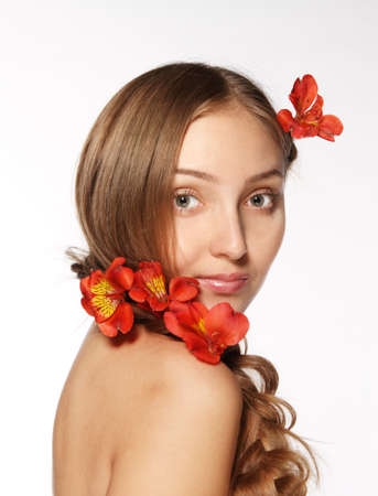Portrait of the beauty young blond girl with lily in her hair Stock Photo - 9160008