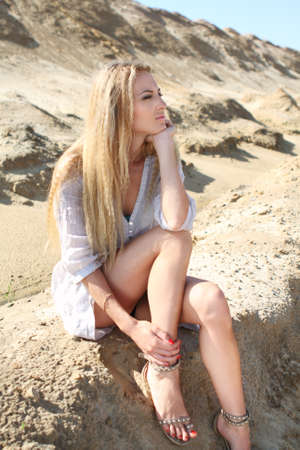Beautiful blond girl in the sunny summer day photo