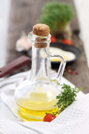Bottle of the olive oil with tomato and cress photo