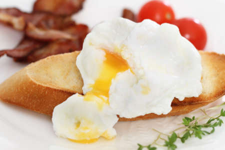 Eggs Benedict on the toast. Breakfast on the plate photo