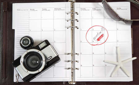 Notebook of the business person waiting for vacation photo