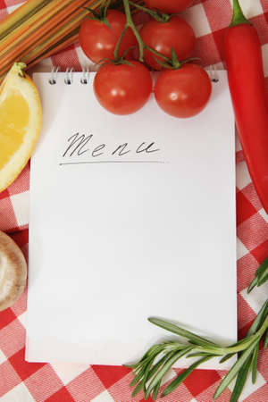 cook book: Vegetables still life with menu blank on checkered background