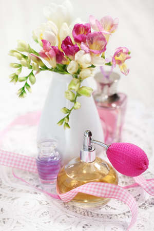 glass vase: Vintage perfume bottles and flowers on the table Stock Photo