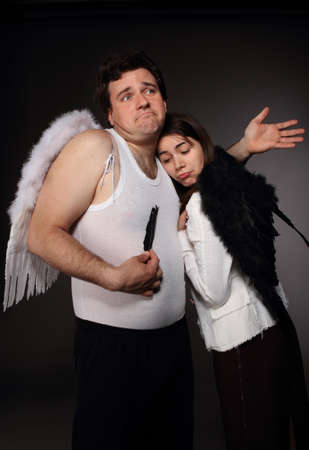 Mr. Angel and Mrs. Angel. Creepy character portrait Stock Photo - 9529946