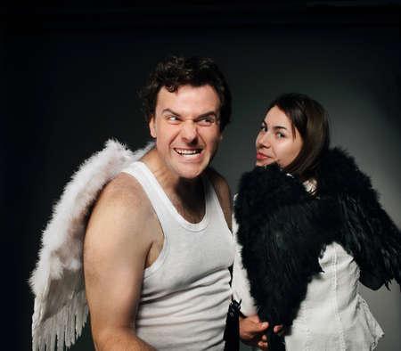 Mr. Angel and Mrs. Angel. Creepy character portrait. Stock Photo - 9529949