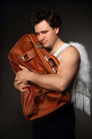 Mr. Angel with brown bag. Creepy character portrait. photo
