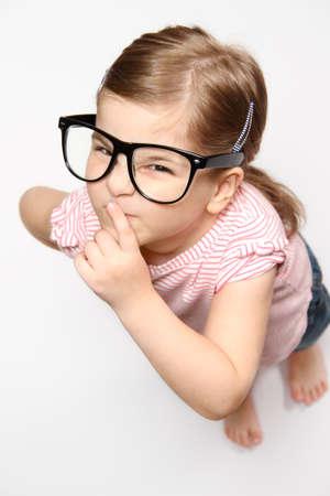 Portrait of lovely smiling girl in glasses photo