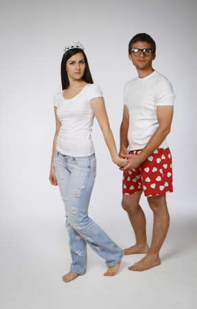 Portrait of a young crazy couple in studio photo
