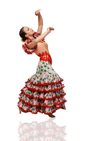 Young woman dancing flamenco with castanets on white background photo