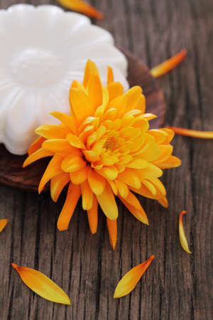 Bar of natural white soap with orange flower photo