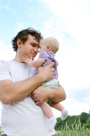 Happy young father with little daughter outdoors photo